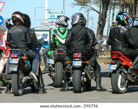 row of motorcyclists