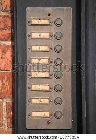 Row of numbered door bell buttons