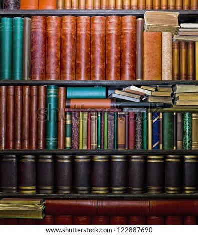Row of old books arranged in bookshelves