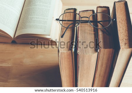 row of old books with reading...