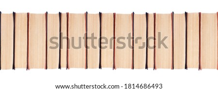 Row of old paper books on white background isolated close up, textbooks spine pattern, long line of hardcover books, education concept, wide border, wallpaper, bookshelf, blank books stack, copy space Stock photo ©