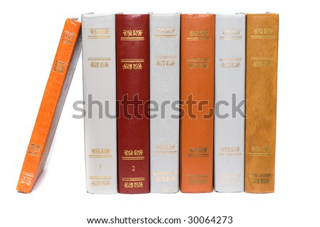 Row of old vintage books isolated on white
