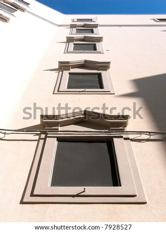 Row of old window on the facade of a palace