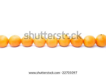 Row of orange mandarins isolated on white