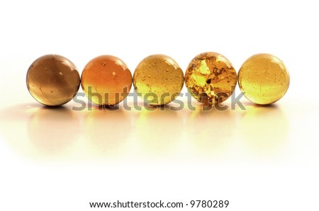 Row of Ordered Golden Glass Marbles - stock photo