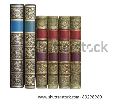 row of ornamented vintage books, isolated on white background