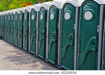 Row of outhouses or porta potties waiting to be used