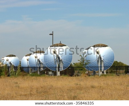 Row of parabolic dish solar reflectors