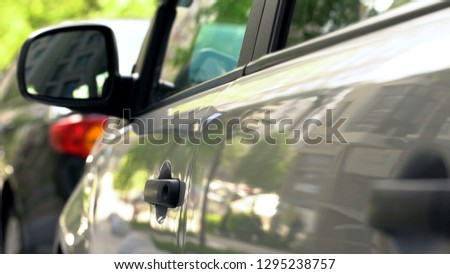 Row of parked cars close up, downtown area, modern transportation, traffic #1295238757