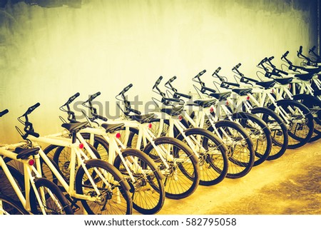 Row of parked colorful bicycles. Many bicycle park in the public park. - Shutterstock ID 582795058