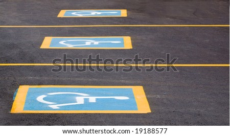 Row of parking spaces with a handicapped sign - horizontal