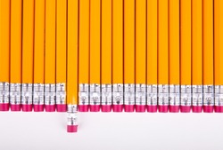Row of pencil erasers arranged in parallel, back to school