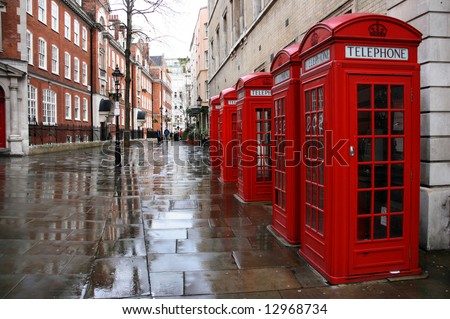 row of phone booths in rainy...