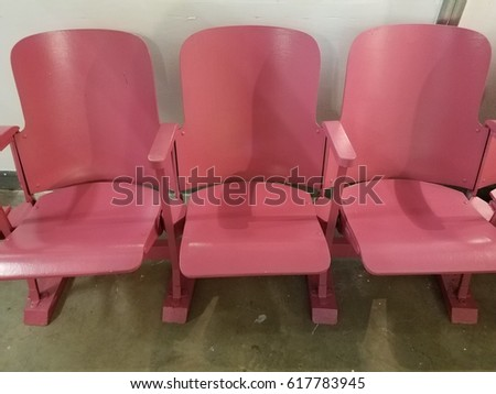 row of pink metal chairs #617783945