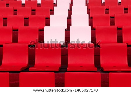row of pink white chair among red in soccer or football stadium sport background #1405029170
