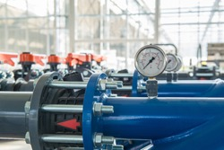 row of plastic pipes with water pressure sensors
