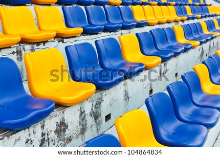 Row of plastic seats at stadium