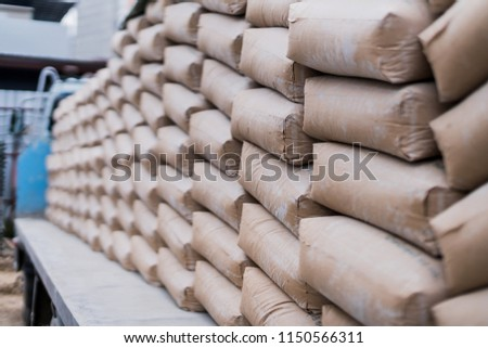 row of raw cement bag stack on truck site construction ideas concept #1150566311