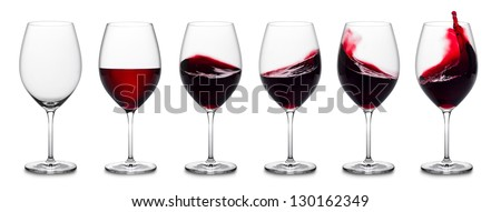 row of red wine glass full empty and with splashes.