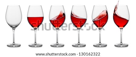 row of rose wine glasses, full, empty and with splashes.