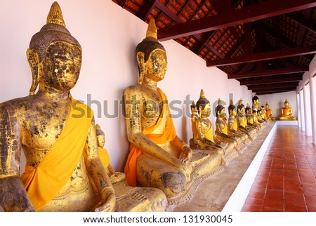 Row of Sacred Buddha images in