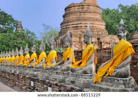 Row of Sacred Buddha images in Ayutthaya, Thailand