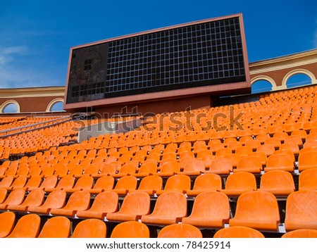 row of seats and score board