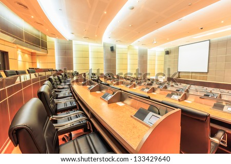 row of seats in empty conference room