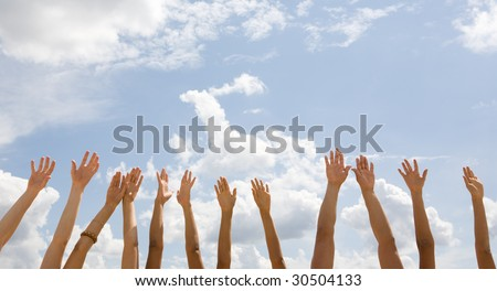 Row of several human hands isolated on a sky background