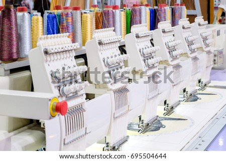 Row of sewing machine on factory industry manufacture, industry 4.0