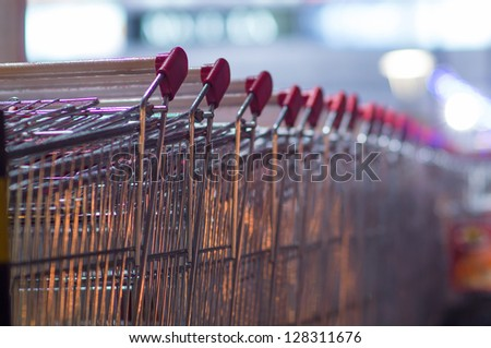 Row of shopping carts at supermarket entrance