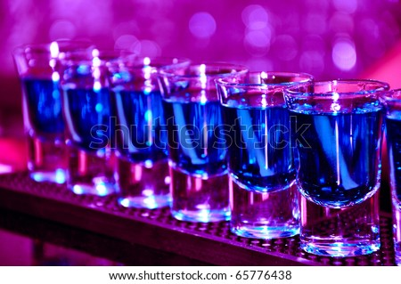 Row of shots on the counter, first is sharp and then they are blurried away