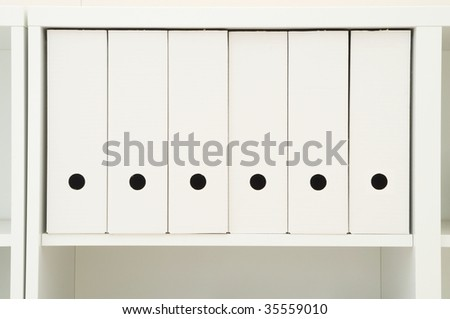 row of six white folder alligned in white funiture