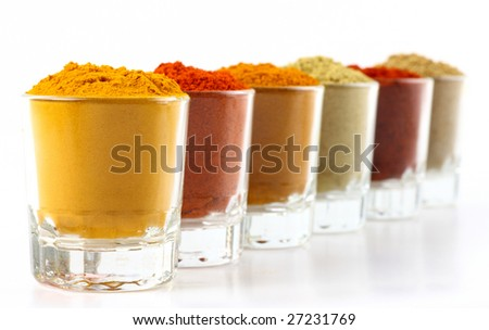 Row of spicy powders used in cooking