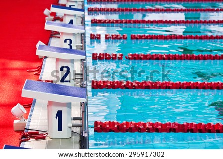 Row of starting blocks in a swimming pool