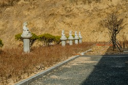 Row of stone carved seated Buddhas at temple at Manbulsa Temple in Yeongcheon, South Korea.