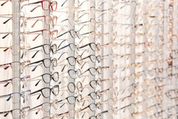 row of stylish glasses at an opticians. side view photo