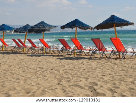 Row of sun beds in the beach of Marbella, Andalusia (Spain)