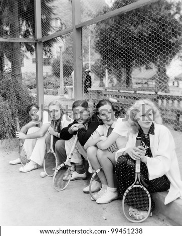 row of tennis players with...