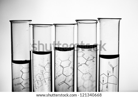 Row of test tubes in black and white style.