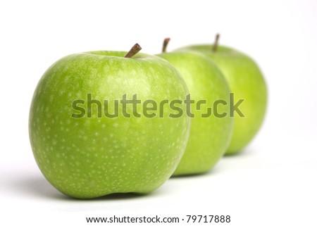row of three apples