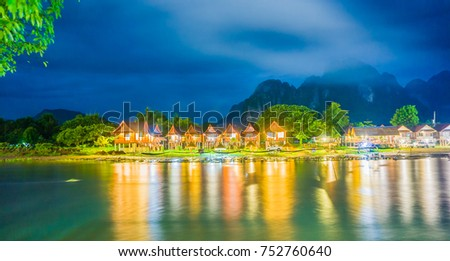Row of tourist resorts along Nam Song River in Vang Vieng. Vang Vieng is a beautiful and relaxing destination which is a popular destination for natural tourism. #752760640