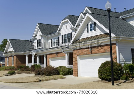 Row of townhouses with garage
