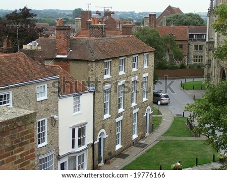 row of traditional British houses in front of Canterbury cathedral, Kent, UK