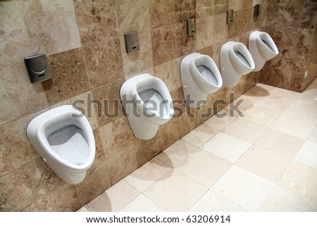 row of urinals in empty clean restroom