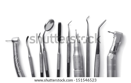 Row of various dental tools isolated on white