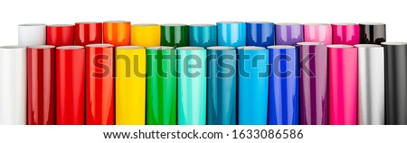 Row of various rainbow colored vinyl car wrapping or plotter cutting sticker foil film rolls isolated on white wide panorama banner background Stockfoto ©