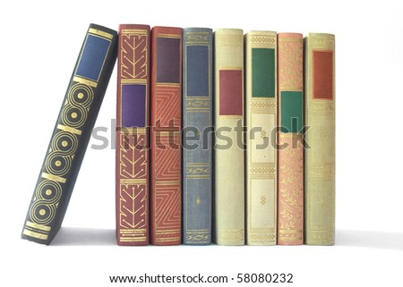 Row of vintage books isolated on white background, blank labels, free copy space