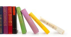 Row of vintage books isolated on white background, free copy space
