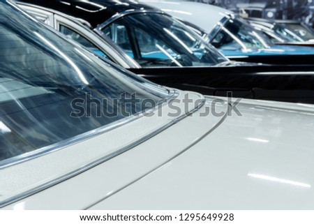 row of vintage cars standing in the background of cityscape, rear view #1295649928